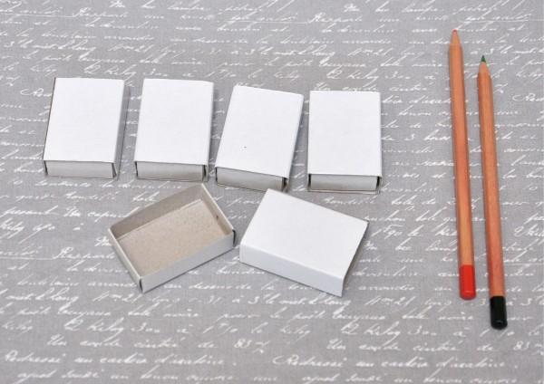 weiße Schachteln / Streichholzschachteln